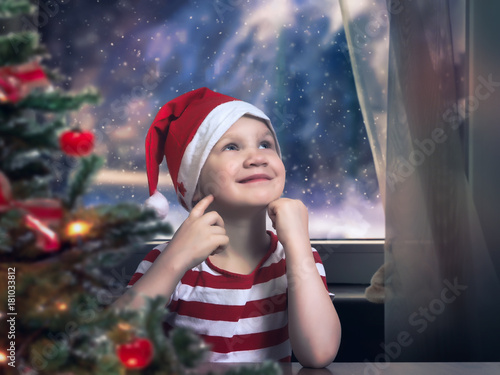 Fotografie, Obraz  Little girl in Christmas hat dreams