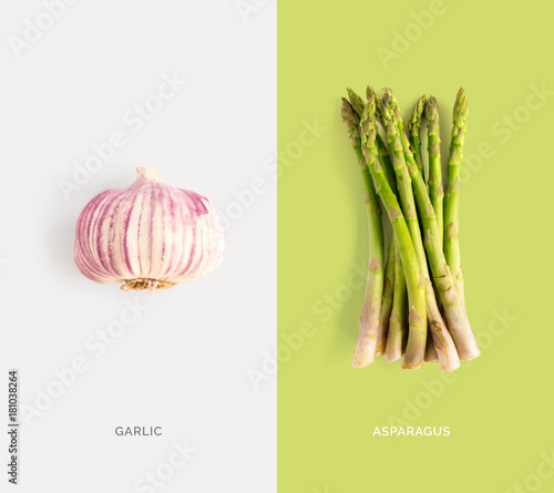 Creative layout made of garlic and asparagus. Flat lay. Food concept.