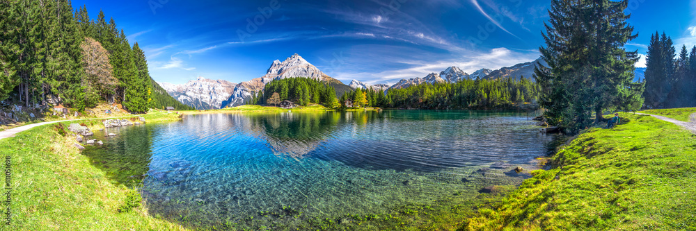 Fototapeta Arnisee with Swiss Alps. Arnisee is a reservoir in the Canton of Uri, Switzerland.