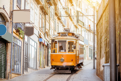 Street view with famous retro tourist tram in the old town of Porto city, Portug Fototapet
