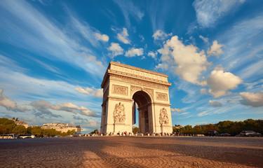 Fototapeta na wymiar Arc de Triumph in Paris with beautiful clouds behind in Fall