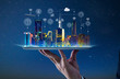 canvas print picture - Waiter hand holding an empty digital tablet with Smart city with smart services and icons, internet of things, networks and augmented reality concept , night scene .