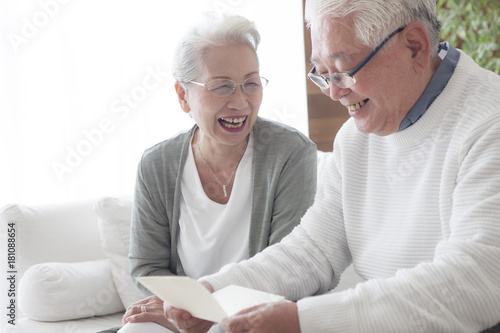 An old man who seems to be happy to receive a letter from his wife Canvas Print