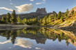 The Averau Mount reflected on the little pond of Limedes at sunset, Dolomites, Cortina D'Ampezzo, Italy