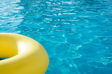 Yellow Swim Ring In A Swimming...
