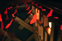 Garland Of Red Hearts On A Dark Background. The Concept Of Valentine's Day