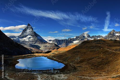 Foto auf Gartenposter Reflexion Mt Matterhorn reflected in Riffelsee Lake Zermatt Canton of Valais Switzerland
