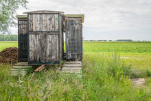 Old Wooden Shed On The Edge Of...