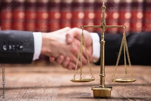 Fototapeta Close-up Of Justice Scale On Wooden Desk obraz