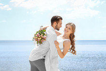 Happy Newlywed Couple On Seash...