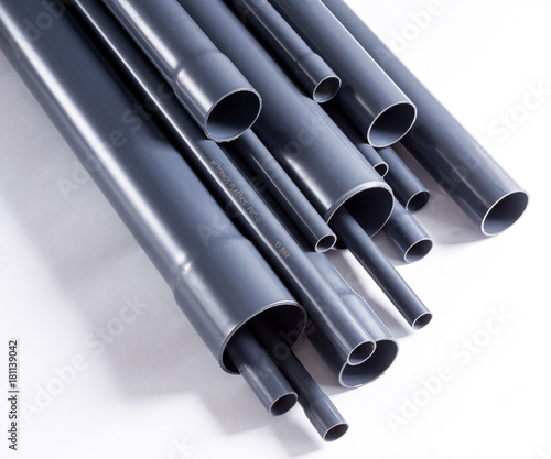 Grey PVC-U watering system pipes is isolated on white. Poster Mural XXL