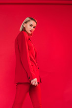 Fashionable Girl In Red Suit