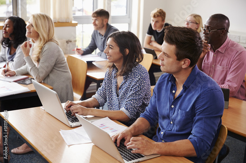 Photo Mature Students Sitting At Desks In Adult Education Class