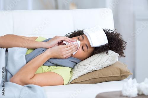 Obraz na płótnie young woman sick on the sofa