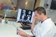 doctor examinating x-ray film from mri roentgen at hospital