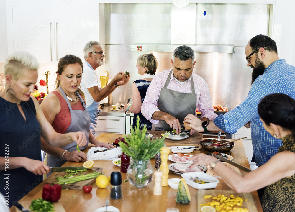 Fototapety, obrazy: Group of friends are cooking in the kitchen