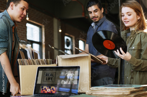Canvas Prints Music store Young people in a record shop