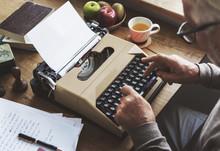 Old Man Typing On A Typewriter