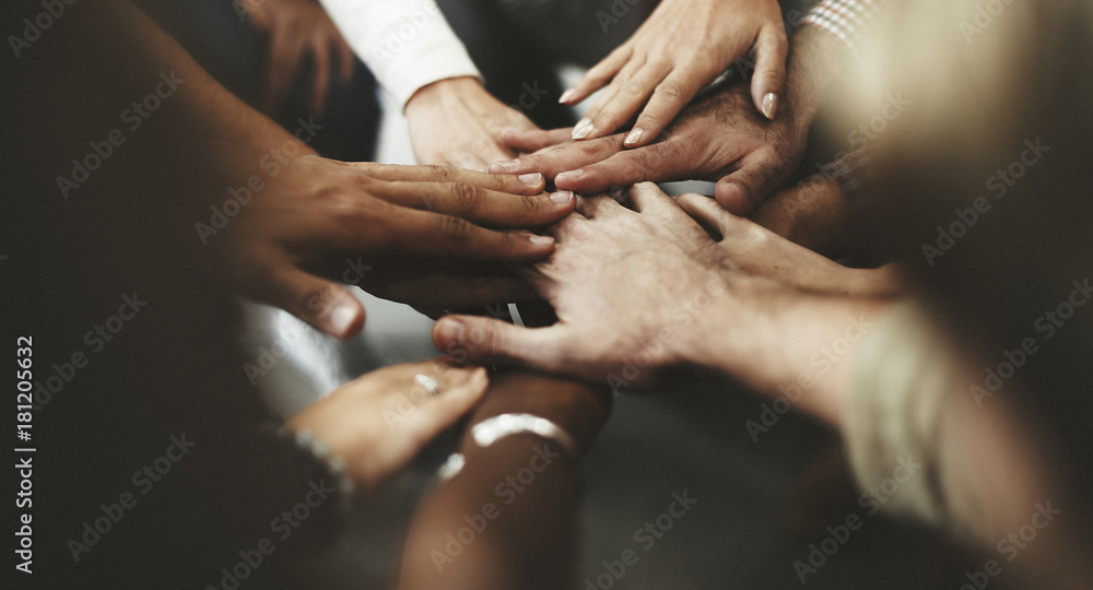 Fototapeta People with joined hands as a team