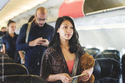 A girl traveling by airplane Billede på lærred