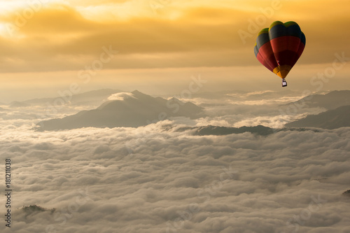 Cadres-photo bureau Marron Beautiful landscape of Foggy morning in the Mountains with hot-air balloons flying over the mountain.