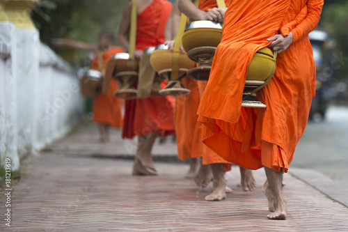 Buddhist monks on everyday morning traditional alms giving in Luang Prabang, Laos Wallpaper Mural