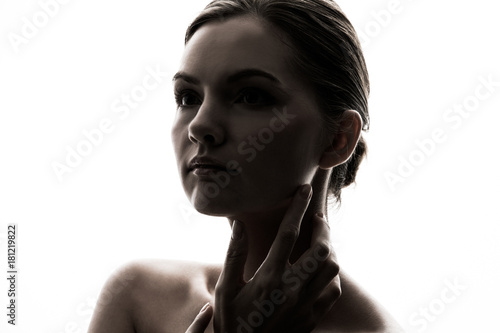 Fototapety, obrazy: Silhouette of young caucasian woman.