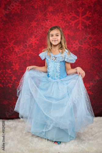 Photo  little girl in cindrella style dress