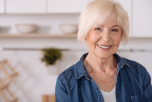 Positive Senior Woman Smiling In The Kitchen
