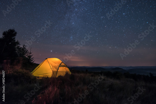 iluminated tent under stars