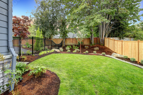 Nice fenced backyard with new planting beds Fototapeta