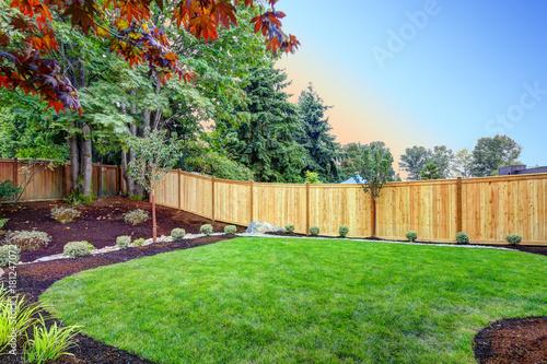 Fotografie, Obraz  Nice fenced backyard with new planting beds
