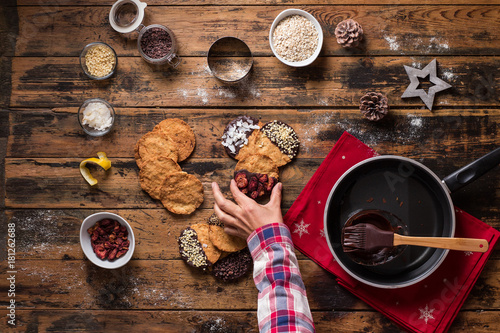Stampe  top view of christmas cookies on wooden table
