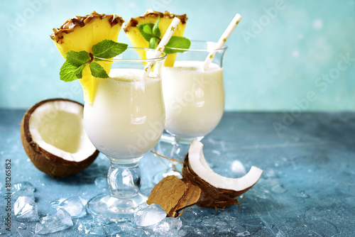Traditional caribbean cocktail pina colada in a glasses.