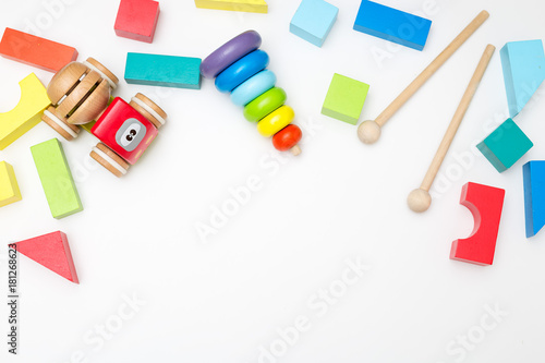Fotografía Wooden toy car and pyramid on white background. Mockup