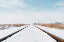 Railroad Tracks Covered In Snow.