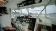 ship at sea, Captain bridge or control room inside view, wide shot