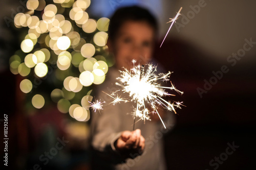 Photo  Child holding a small firework