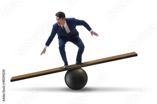 Fotografia, Obraz  Businessman balancing on seesaw in uncertainty concept
