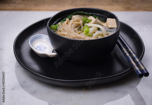 Fotografie, Obraz  Japanese udon noodle soup with enoki mushroom, tofu and Gai lan