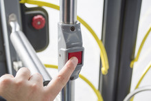 Man Pressing Button On Bus