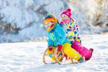 Kids Play In Snow. Winter Slei...