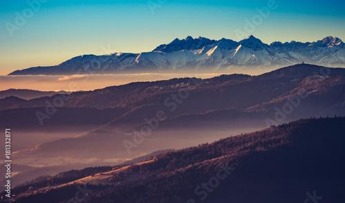 Fototapeta panorama over misty Gorce to snowy Tatra mountains in the morning, Poland landscape obraz na płótnie