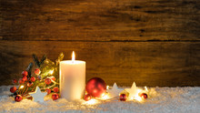 Christmas Decoration With Candle Light And Traditional Ornaments At Snow