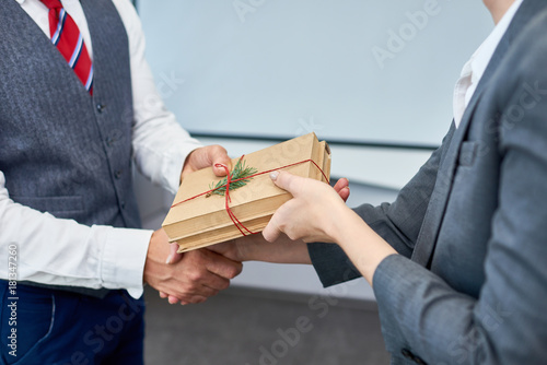 Fotografía  Close up view of unrecognizable businessman shaking hands with female colleague