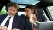 Business people in car working and flirting tracking shot