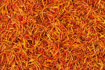 Fototapeta Dried saffron spice as a background, natural seasoning texture