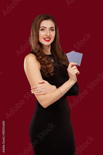 Fototapeta Beautiful confident woman showing poker cards looking at camera with copy place obraz na płótnie