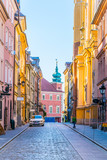 Fototapeta Uliczki - Novomiejska street leading towards the royal castle in Warsaw, Poland.
