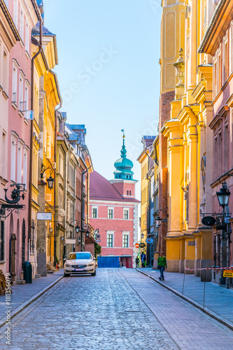 Canvas Prints Narrow alley Novomiejska street leading towards the royal castle in Warsaw, Poland.